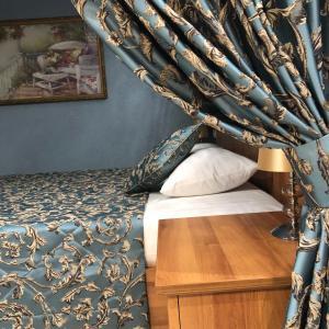 Кровать или кровати в номере IsaBella Holiday Home