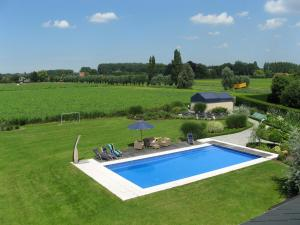 A view of the pool at B&B Au Grenier or nearby