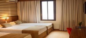 Cama ou camas em um quarto em Hotel Continental Business - 200 metros do Complexo Hospitalar Santa Casa