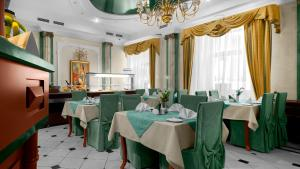 A restaurant or other place to eat at Arkadia Hotel