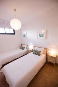 Cama o camas de una habitación en Surfers Retreat