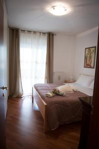 A bed or beds in a room at Casa Menhir AeT