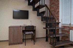 Телевизор и/или развлекательный центр в Апельсин Отель на Дубровке