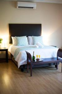 A bed or beds in a room at The Graaff-Reinet Suites