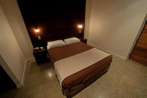 A bed or beds in a room at Sovereign Resort Hotel