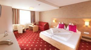 Postel nebo postele na pokoji v ubytování Haus Central