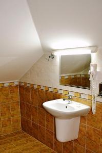 A bathroom at Family Hotel Miglena
