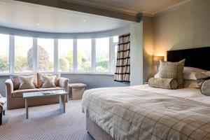 A bed or beds in a room at The Grand at Grasmere