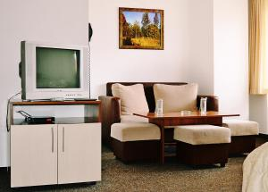 A television and/or entertainment center at Family Hotel Miglena