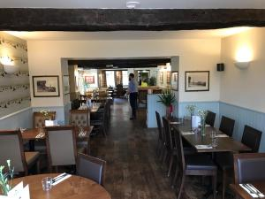 A restaurant or other place to eat at The Black Swan Inn