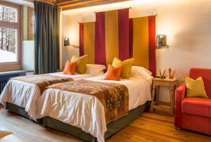 Letto o letti in una camera di Saint Hubertus Resort