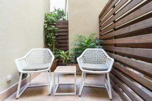 A balcony or terrace at Hotel Casa 1800 Sevilla