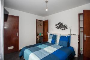 A bed or beds in a room at RENTY Côté Parc Parking inclus