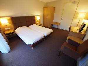 Ein Bett oder Betten in einem Zimmer der Unterkunft Hotel Bos en Duinzicht