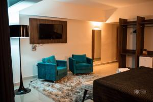 A television and/or entertainment center at Ipe Center Hotel