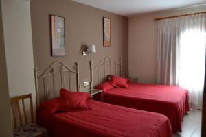 A bed or beds in a room at Los Palacios
