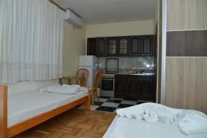 A bed or beds in a room at Hotel Bella Donna