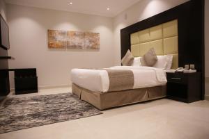 Cama ou camas em um quarto em Nasima Hotel Apartements