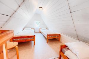 Säng eller sängar i ett rum på Mötesplats Borstahusen