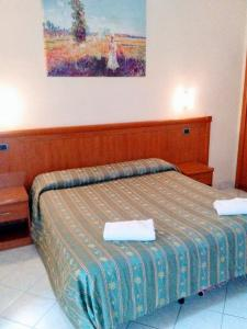 A bed or beds in a room at B&B Starlight