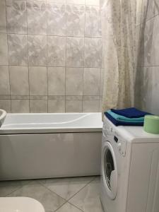 Ванная комната в Apartment on Chuykova 37