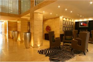 The lobby or reception area at Alassia Hotel