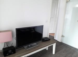 Een TV en/of entertainmentcenter bij Stadtoase Koblenz