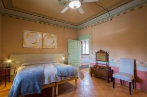 Un pat sau paturi într-o cameră la Villa Sant'Andrea