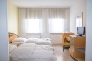 Ein Bett oder Betten in einem Zimmer der Unterkunft Pension Tokus
