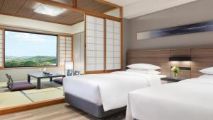 A bed or beds in a room at Nanki-Shirahama Marriott Hotel