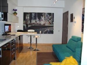 A kitchen or kitchenette at Triana-Teatro