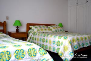 A bed or beds in a room at Casa Amanda B&B