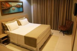 A bed or beds in a room at Dunen Hotel