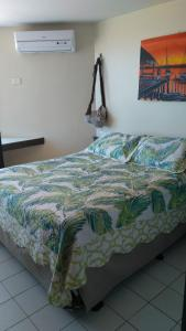 A bed or beds in a room at Victory Business Flat