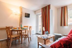 A restaurant or other place to eat at Résidence Pierre & Vacances La Rivière