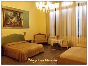 Cama ou camas em um quarto em Palazzo Lion Morosini
