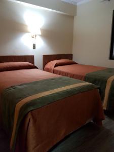 Cama o camas de una habitación en Hotel Diego de Almagro Antofagasta Express