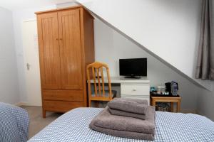 A television and/or entertainment center at Dean Park Guest House