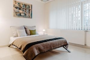 Ein Bett oder Betten in einem Zimmer der Unterkunft First Wohnen GmbH