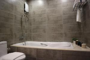 A bathroom at CASA Meridian Residence