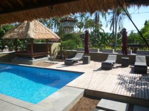 The swimming pool at or near Le Jardin