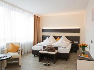 Ein Bett oder Betten in einem Zimmer der Unterkunft Concorde Hotel am Leineschloss