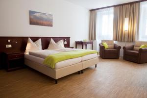Ein Bett oder Betten in einem Zimmer der Unterkunft Stadthotel Waidhofen an der Thaya