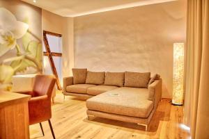 Ein Sitzbereich in der Unterkunft Flair Hotel Nieder