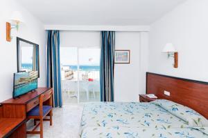 Un ou plusieurs lits dans un hébergement de l'établissement HSM Hotel Reina del Mar