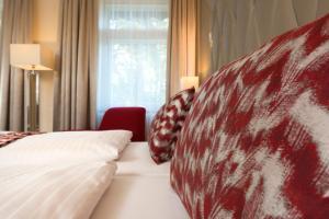 Ein Bett oder Betten in einem Zimmer der Unterkunft Radisson Blu Badischer Hof Hotel