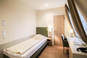 Un ou plusieurs lits dans un hébergement de l'établissement Hotel Axel Springer