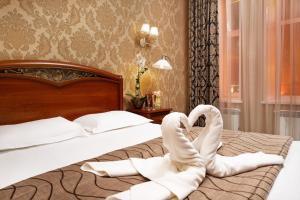 Кровать или кровати в номере Бутик отель Рождественский Дворик