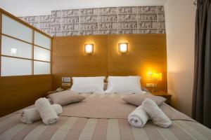 Letto o letti in una camera di Hotel Life