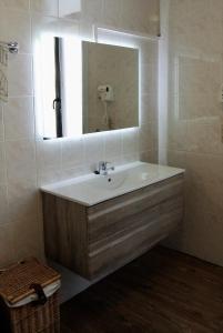 Ein Badezimmer in der Unterkunft Hotel Tropicana